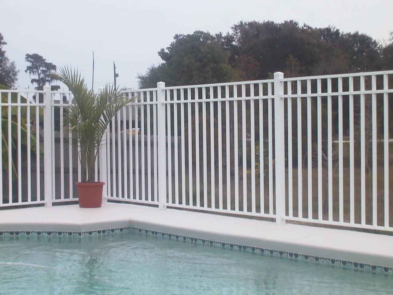 An image of an aluminum fence installed in a pool area in a home in Miramar
