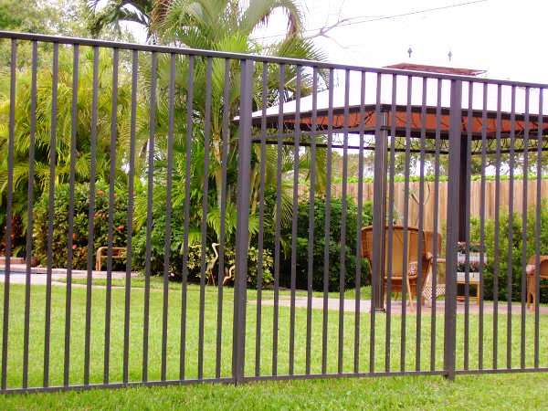 An image of an aluminum fence installed in a community in Weston