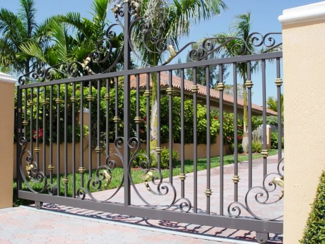 A custom mechanical fence we designed and installed in a private residence in Cooper City