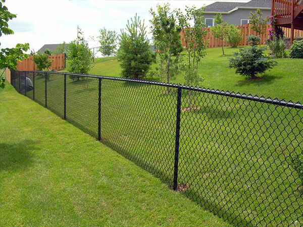 Chain link installation and repair in a residential area in Pembroke Pines, FL