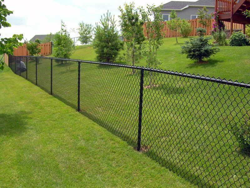 A black chain link fence we installed in a community in Plantation, FL