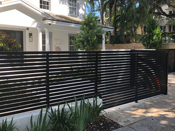 Fence and automatic gate maintenance in a Fort Lauderdale home.