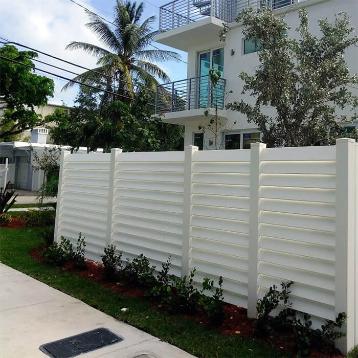 An elegant vinyl fence installed in a private townhome in Fort Lauderdale, Broward County, FL