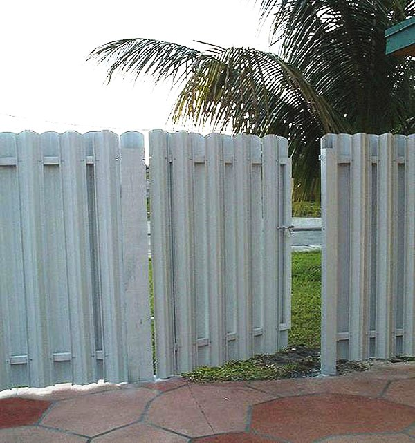 A privacy metal fence that we installed in a pool area